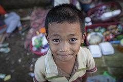 Unidentified young asian little boy. Sangkhlaburi, Thailand - January 23, 2015: Unidentified young asian little boy at Mon village in Sangkhlaburi,Thailand Royalty Free Stock Photography