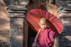 Unidentified young Buddhism novices make a suspicious with the stranger tourist Royalty Free Stock Images