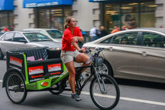 Unidentified Young Female Trishaw Driver On Downtown Street Royalty Free Stock Photography