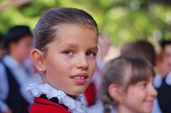 Pure beauty. Portrait of a young szekler girl. Unidentified young girl in traditional szekler clothes gaze at the camera with his beautiful pure green eyes Stock Photo