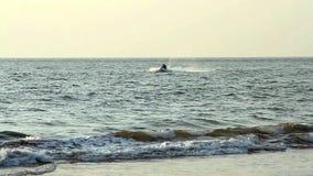 Unidentified Young guy cruising on a jetski. Goa state Vagator beach stock footage