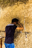 Unidentified  young  jewish worshiper in skullcap   praying at the Wailing Wall an important jewish religious site Stock Photo
