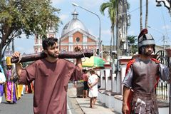 Unidentified young man playing role of thief carrying logs, street drama, community celebrates Good Friday representing the events. San Pablo City, Laguna royalty free stock photos