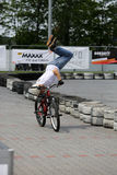 Unidentified young man rides his BMX Bik. E  at 3rd edition of MOTO SHOW in Krakow Royalty Free Stock Photography