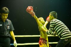 Unidentified young Muaythai fighters in ring during match, on Chang, Thailand. Stock Image