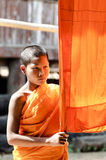 An unidentified young novice monk 12 years old poses for a phot. KANCHANABURI THAILAND-January 29: An unidentified young novice monk 12 years old poses for a royalty free stock photos