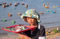 Unidentified young seller in Fishing village. Mui Ne. Vietnam Stock Photos
