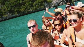 Koh Samui, Thailand, 14 february 2016. Unidentified young tourists traveling in the boat on the sea. slow motion. Unidentified young tourists traveling in the stock video footage