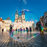 Unidentified young woman makes soap bubbles in Old Town Square in Prague, Czech Republic Royalty Free Stock Image