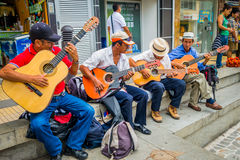 Unidentify indigenous men playing guitar in the Stock Images