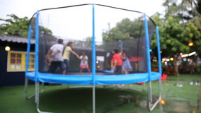 Unidentify Kids jumping on trampoline . stock video