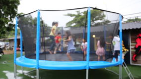 Unidentify Kids jumping on trampoline . stock footage