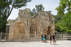Unidetified tourists are looking at roman ruins in Nimes Royalty Free Stock Photo