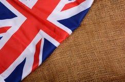 Unie Jack United King Flag Banner op Jutetextuur Royalty-vrije Stock Afbeelding