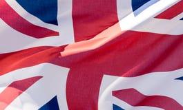 Unie Jack Waving Flag M Close Up Royalty-vrije Stock Afbeeldingen