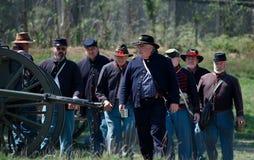 Unie militairen met kanon Stock Afbeelding