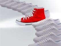 Unieke rode rubberschoen Royalty-vrije Stock Fotografie