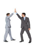 Unified business team high fiving each other. On white background Royalty Free Stock Image