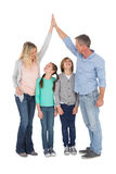 Unified couple high fiving each other with their child below. On white background Royalty Free Stock Photography