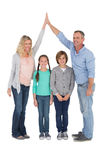 Unified couple high fiving each other with their child below. On white background Stock Photo