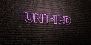 UNIFIED -Realistic Neon Sign on Brick Wall background - 3D rendered royalty free stock image Stock Photos