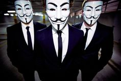 Uniform appearance. Close-up portrait of a group of people of the uniform appearance wearing Guy Fawkes masks Stock Photo
