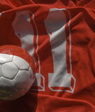 Uniform and ball. Number eleven uniform and ball red white Stock Photo