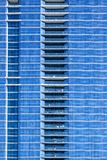 Uniform blue facade. Facade of an anonym and uniform looking blue skyscraper royalty free stock images