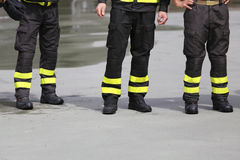 Uniform boots of firefighters inthe firehouse. Uniform boots of italian firefighters inthe firehouse Stock Image