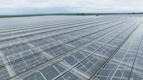Uniform greenhouse roof tiles in close view. Ridged greenhouse roof sections last up to the horizon line stock video footage