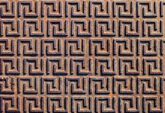A uniform pattern on an old rusty iron surface. View from above royalty free stock image
