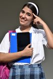 Uniforme colombiano católico de Thinking Wearing School da estudante fotografia de stock royalty free