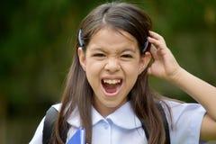 Uniforme de And Anxiety Wearing da estudante da criança da minoria foto de stock