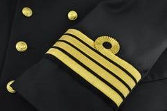 Uniforme del blu marino, capitano Fotografie Stock Libere da Diritti