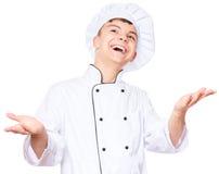 Uniforme del cocinero del muchacho que lleva adolescente Fotografía de archivo libre de regalías