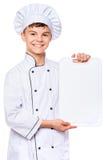 Uniforme del cocinero del muchacho que lleva adolescente Fotos de archivo
