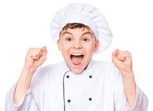 Uniforme del cocinero del muchacho que lleva adolescente Imagen de archivo libre de regalías