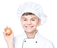 Uniforme del cocinero del muchacho que lleva adolescente Imagenes de archivo