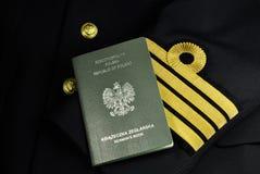 Uniforme del marinero con el libro del marinero, capitán naval, Imagenes de archivo