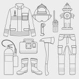 Uniforme del vigile del fuoco e primi insieme e strumenti dell'attrezzatura di aiuto Fotografia Stock Libera da Diritti