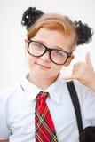 Uniforme scolastico della ragazza abbastanza teenager e borsa di scuola d'uso Istruzione Colpo dello studio Fotografia Stock