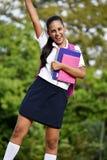 Uniforme vestindo da menina colombiana bem sucedida da escola fotos de stock