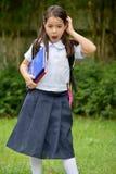 Uniforme vestindo de Child Under Stress do estudante com cadernos imagem de stock royalty free