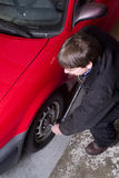 Auto Technician Tightens Lug Nuts after Changing F Stock Image