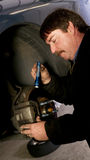 Auto Technician Mechanic Checks Brake Pads and Rot Stock Photo