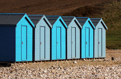 Uniformed Beach Huts. Row of Beach Huts uniformed at Charmouth Dorset, Uk Royalty Free Stock Photography