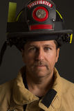 Uniformed Firefighter Portrait on Dark Background Stock Photos