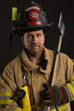Uniformed Firefighter Portrait on Dark Background Royalty Free Stock Images