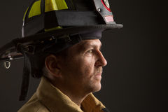 Uniformed Firefighter Portrait on Dark Background Stock Photo