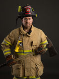 Uniformed Firefighter Portrait on Dark Background Royalty Free Stock Photos